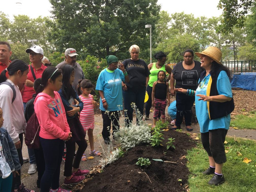 Bonnie Ora Sherk instructing the group before planting; Roosevelt Island Day, June 17, 2017 on Roosevelt Island, NYC