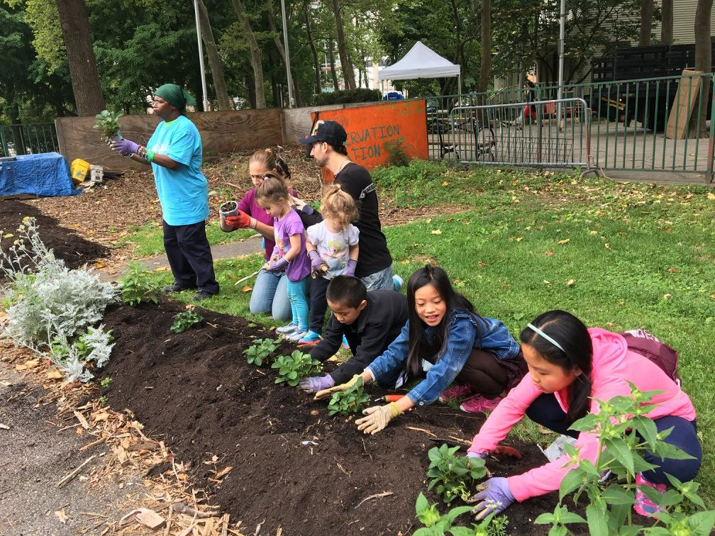 Kids planting the trees in RI Living Library & Think Park on Roosevelt Island Day, June 17, 2017 at Roosevelt Island, NYC