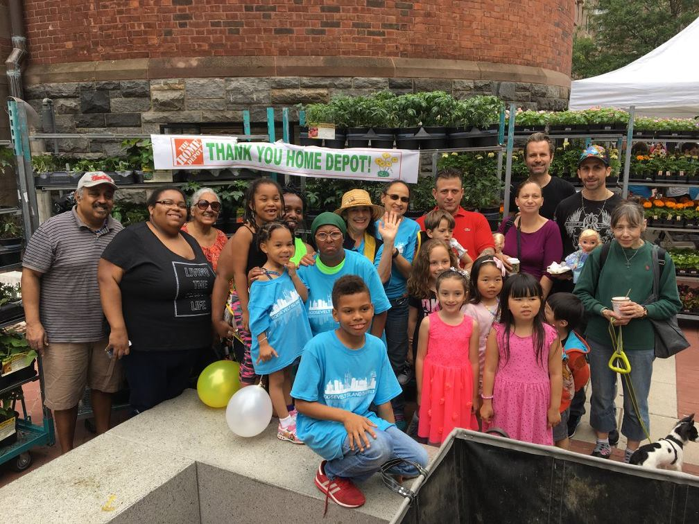 Bonnie Ora Sherk with a group of enthusiastic kids and their parents on Roosevelt Island Day, June 17, 2017 at Roosevelt Island, NYC