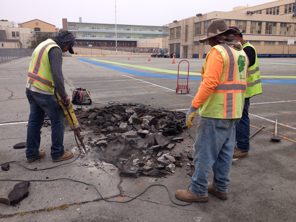 Digging up asphalt and concrete at the Rear Yard of James Denman Middle School